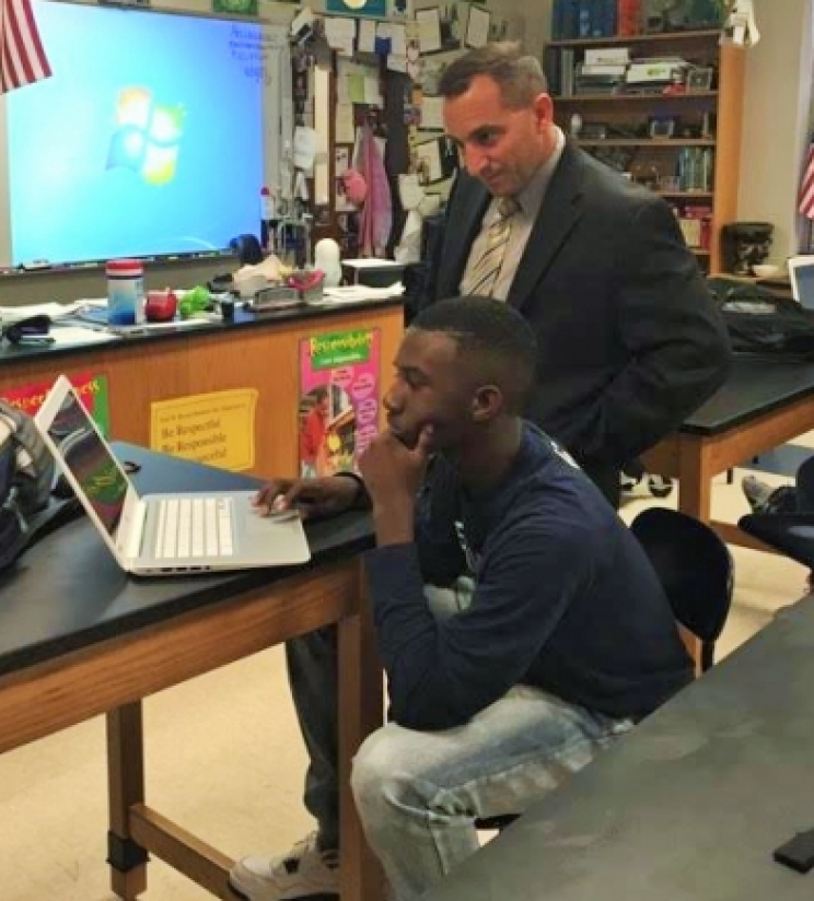 Dr. Mike Daria, shown here watching student James Dent takes an assessment on a school-provided Chromebook at Paul W. Bryant High School in April 2016, is the new Tuscaloosa City Schools Superintendent.