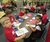 Kindergarten students get busy on morning work on the first day of school at Holy Spirit.