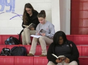 Students Izzy Sullivan, Emily Campbell and Jazmine Moss take part in the all-school read.
