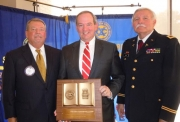 L to R: Orman Wilson, who presented the award; honoree, Jordan Plaster, and Col Glen Smith, U.S. Army (ret) who was program host.